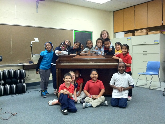 Piano donation to Pfeiffer-Burleigh Elementary School