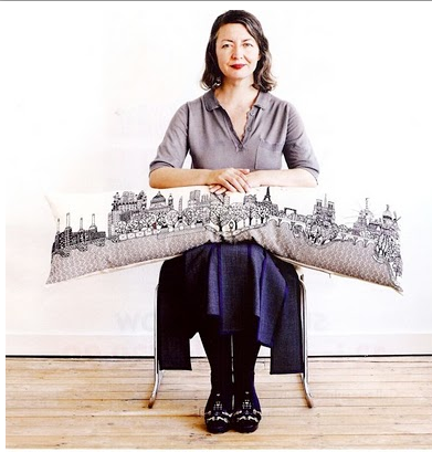 Designer Charlene Mullen and one of her panoramic embroideries.