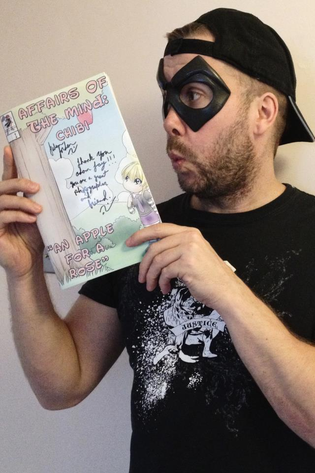 Adam Jay of Super Hero Photography, holding his very own AOTM: Chibi Book