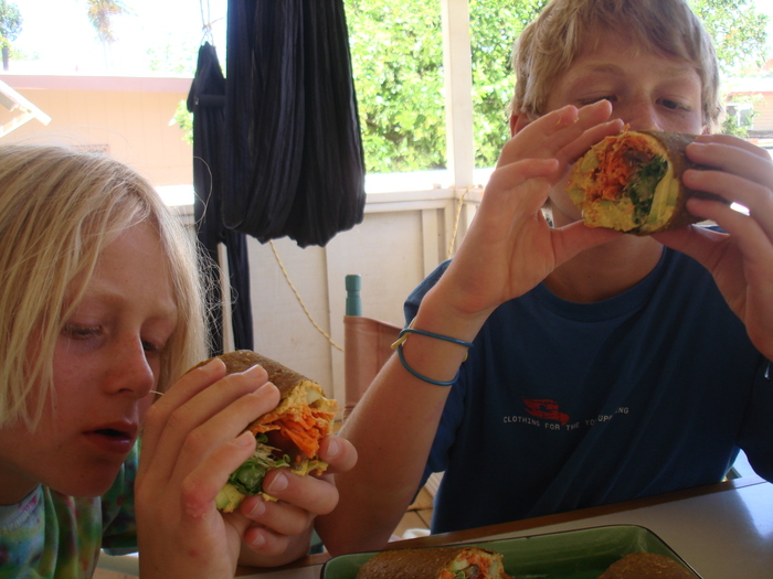 Tone's children Gabriel and Noah digging into the MANA WRAPS