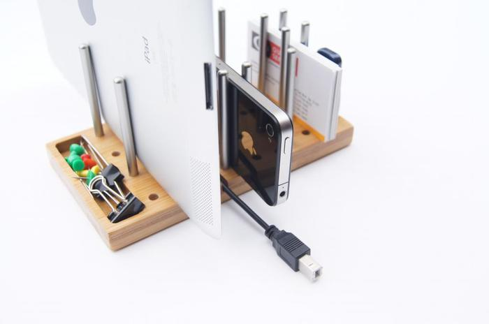 Modo shown with iPad, iPhone, business cards, USb flash drive, Charging cable, push pins and paper clips - All effectively managed.