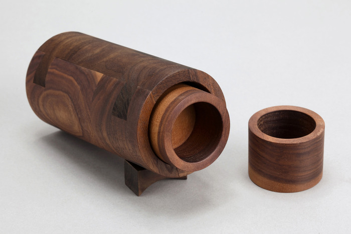 2 turned shot glasses for special occasions. comes with turned dovetail case.  walnut