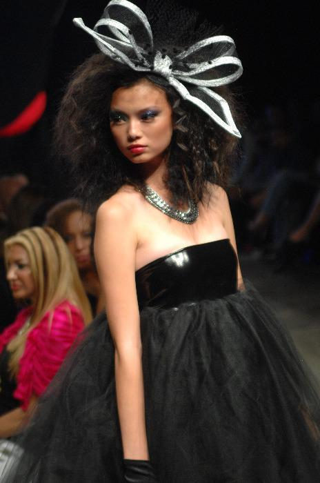 A large bow fascinator rocking the runway