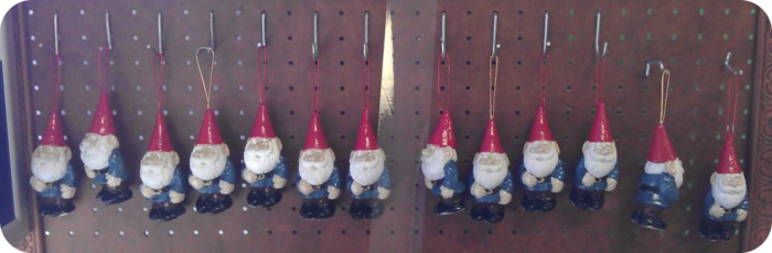 Christmas gnome ornaments hanging to dry.