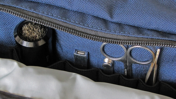 Milspec webbing is used to keep grooming essentials organized in the side pocket.