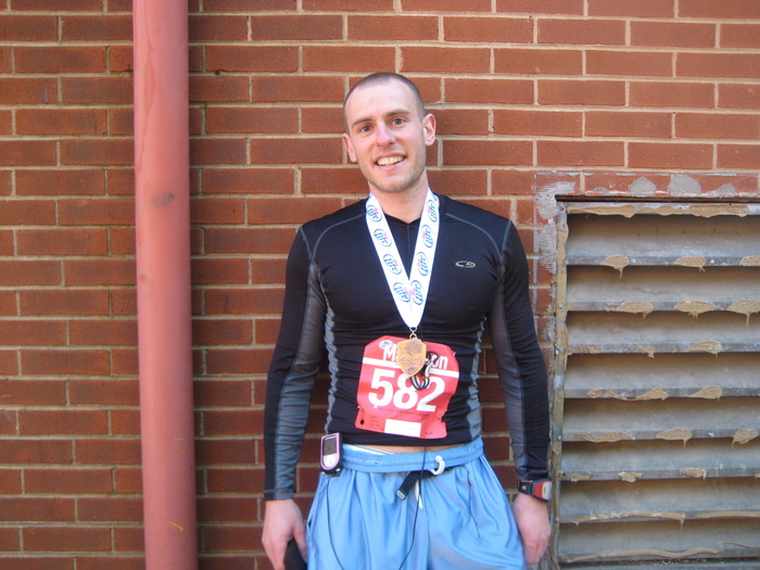 In preparation for one of my Ironman Triathlons, I ran the Charlottesville Marathon.  Here I am after the race with my finisher's medal.