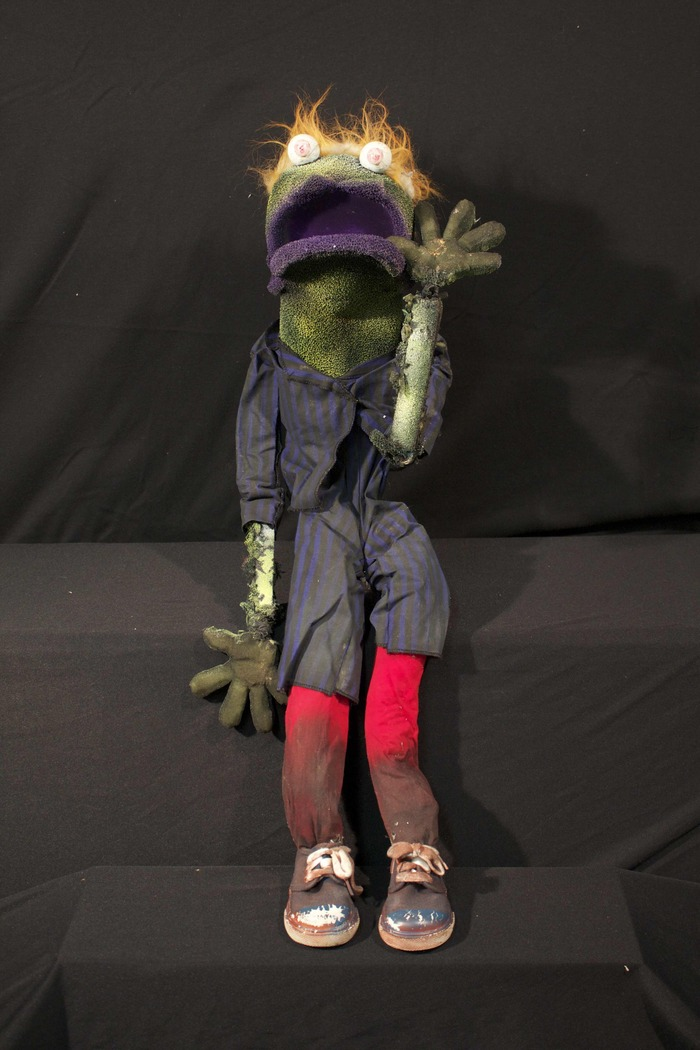 Natty Bumpo - Natty Bumpo is one of the original zombies dug up from the graveyard and accidentally falls through a grave into the Tailgators' Underground.  He and the Mail Puppet got to feast on the party animals all on their own.