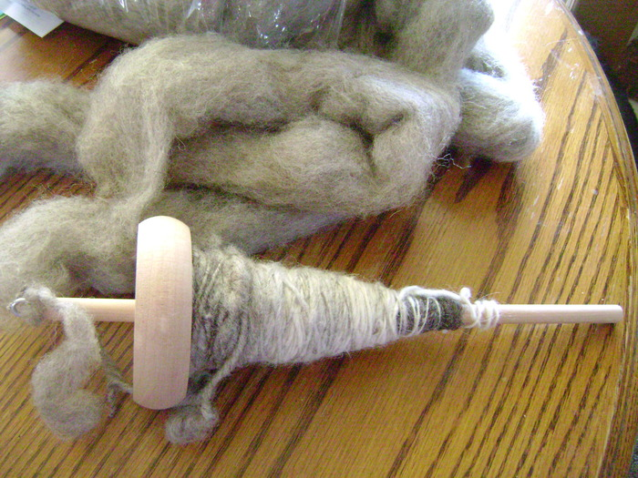 Handspun wool on a drop spindle