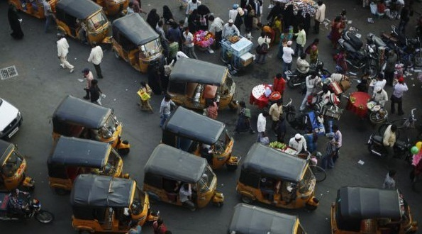Three wheel taxi's and small vans make up a significant proportion of the traffic in India's cities.