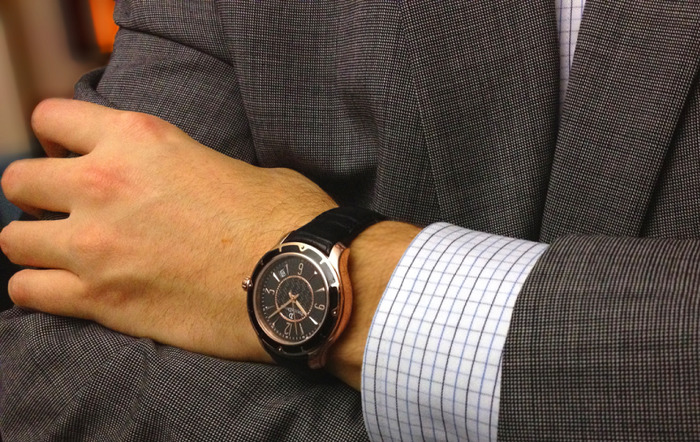 Pictured: Casual Friday watch with black leather strap on a man's wrist.