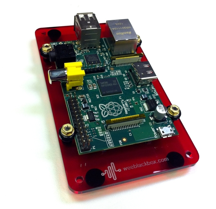 Raspberry Pi mounted on a Space Station BASE plate. Rubber grommets hold the Pi securely in place. The posts and lid may be added, or can be left open allowing quick access to IO ports.