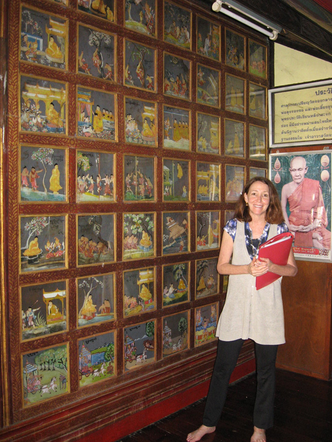 respectfully barefoot in Wat Chong Klang, by some of the 185 paintings