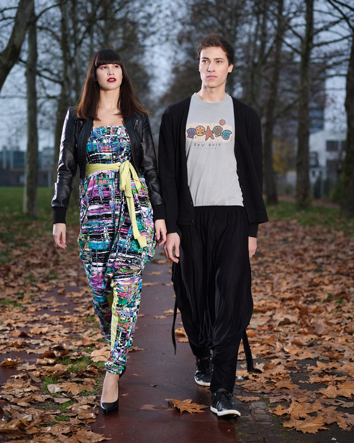 She wears print+color. He wears color+color.