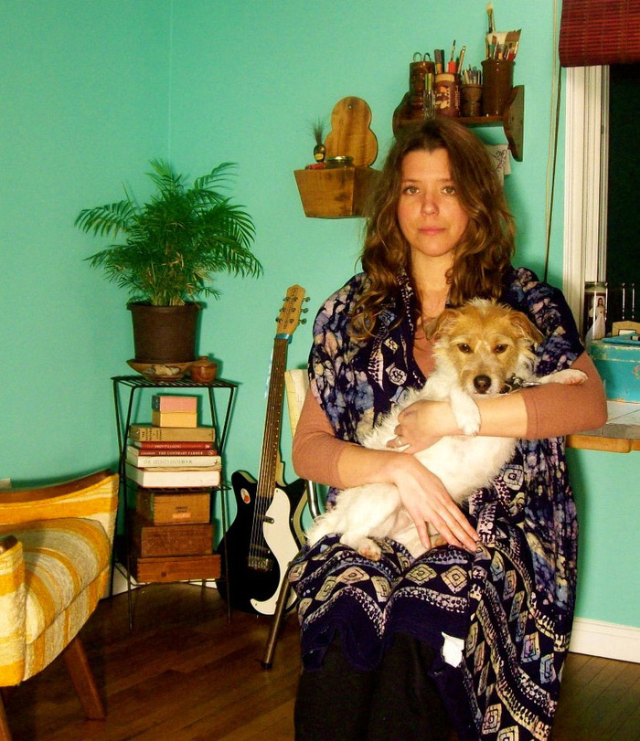 Meagan Alwood-Karcic and her dog Rose in their studio in Columbus, Ohio.