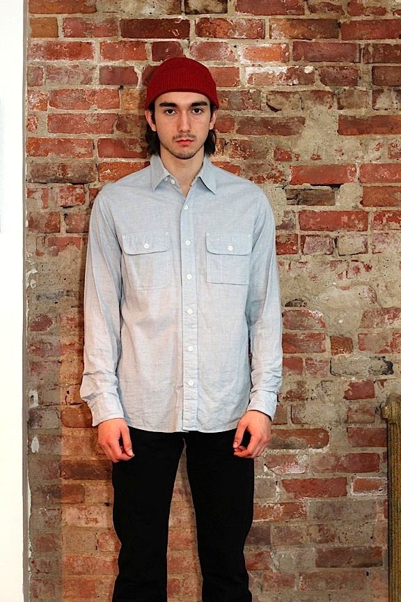 """Big Yank"" Shirt in Japanese 100% cotton chambray. Re-enforced elbows. Bellowed tobacco/pen pocket. Chinstrap.  Double needle chain stitch and single needle straight stitch construction. Bar tacking at points of strain. Gusseted side seams. Four hole dish"