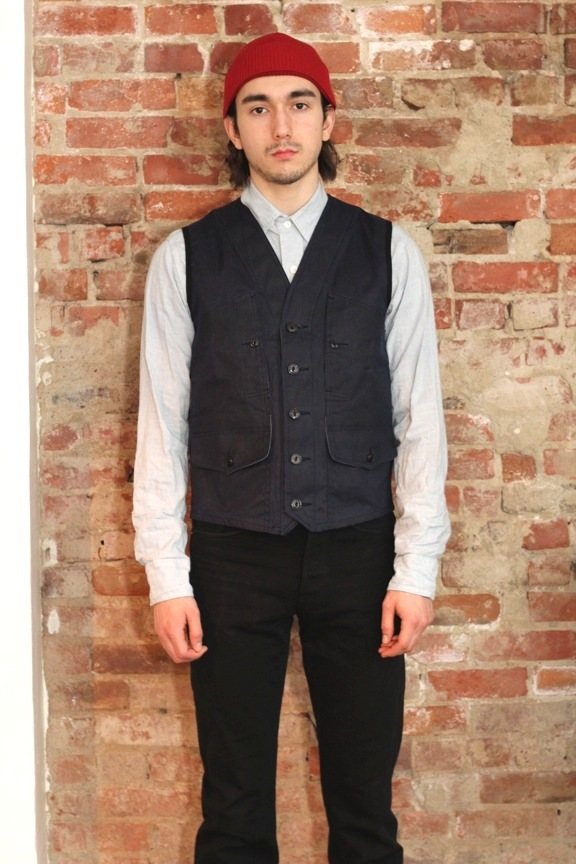 """Imperial"" waistcoat in U.S. 100% soft cotton duck. Contrasting Japanese blue chambray back cinch and facing. Herringbone cotton twill tape finished seams. Cats eye buttons."