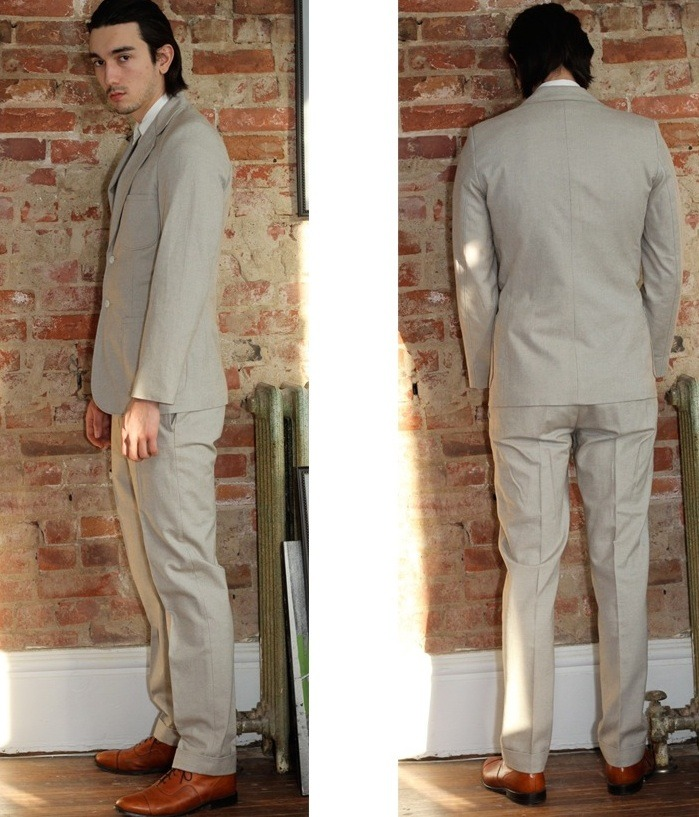 """Palm Beach"" trouser. Japanese 100% two tone brushed cotton twill in the colour stone. Cats eye button fly. 2 slash front pockets and 2 back pockets. 1 with cats eye button closure. Cuffed hem."