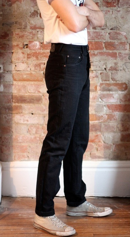 """CALI SLIM"" Black Japanese 100% cotton non selvage yarn dyed denim. Tone on tone black thread. Double needle chain stitched flat feld seams. Single needle straight and chain stitching. Bar tacking at points of strain."