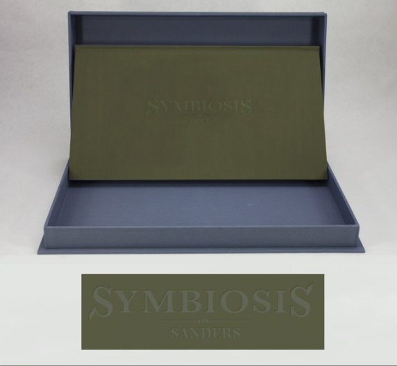 Mock-up of Symbiosis book with debossed logo, in clamshell box.