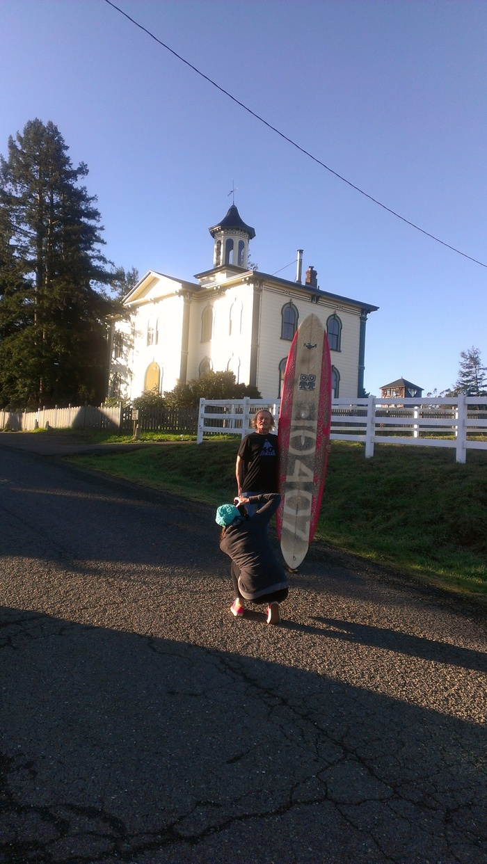 Lucia Griggi photographing Dale Webster with the board he rode every day for 10,000+ days, without fail.