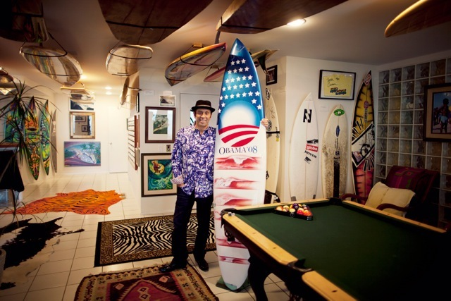 Fernando Aguerre with his Obama board.