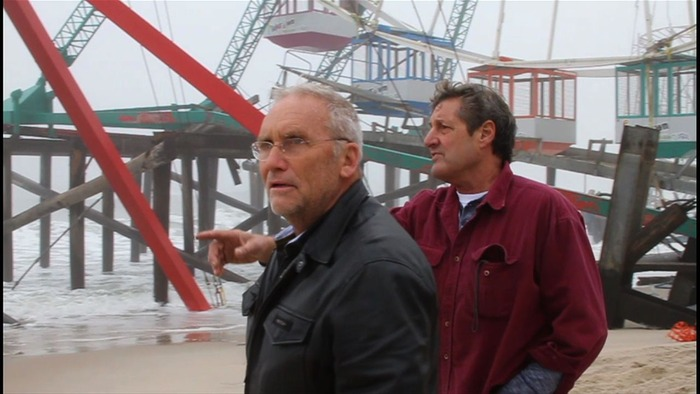 Greg Mesanko and Jim Purpuri survey the damage at the Pier