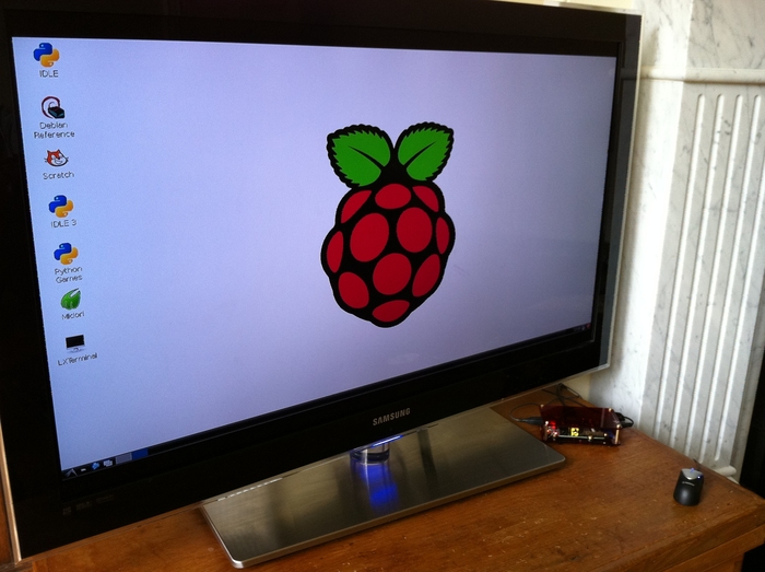 Raspberry Pi mounted in a Space Station enclosure connected via HDMI cable to a TV.