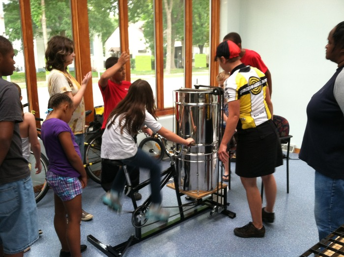 McKinley Flower Team extracting honey by bike