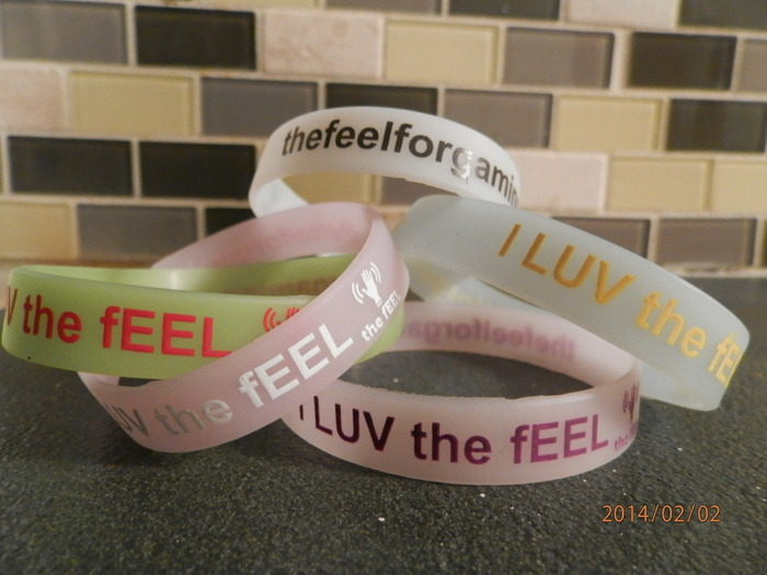 Limited Edition thefEEL wristband (Glows in the Dark) color of your choice white, sky blue, green, pink, purple. All pledges that include thefEEL wristband.