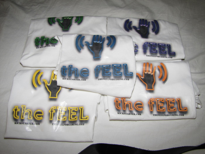 Special limited Edition thefEEL white tee. Colors: Yellow, Purple, Orange, Blue, Green s-XL on GILDAN 5.3oz