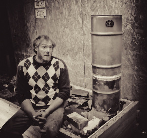 ernie sitting on the hottest rocket stove ever made