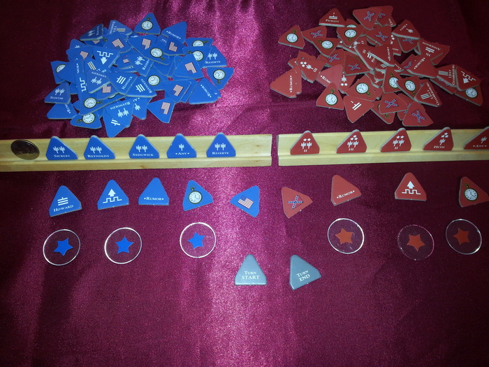i)  2 Custom Wooden Racks made from solid Cherry wood.   ii) 148 Cardboard tiles/tokens - time tokens, reinforcement tokens, battle tokens, and turn markers.  iii) 6 Objective Disks