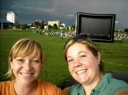 Here're Jeanine and Liz -- and a big inflatable screen and growing crowd in the background!