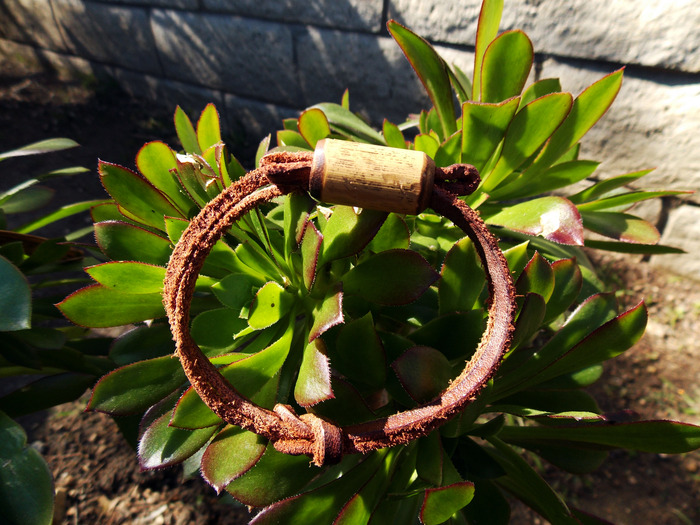 This simple bracelet, made from the leather remnants, has a bamboo bead for a personalized fit. This is what you will receive for the $5 Reward Option.