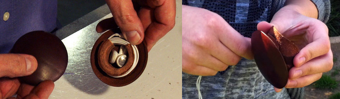 Cutaway to show how the earbuds nest safely in the center of the shield.