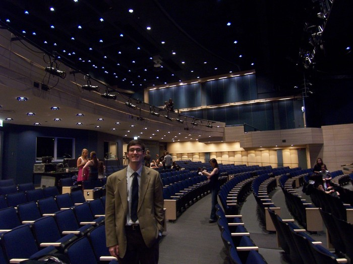 Scott stands in a multi-purpose theater in Chicago that he just completed. An hour later, Sheryl Crow rocked the stage.