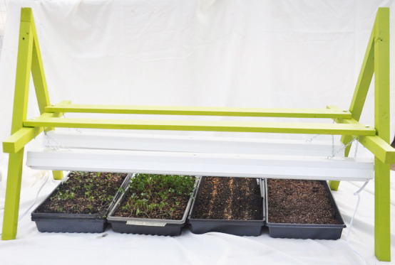 Our grow light stands for seedlings-- our own design!