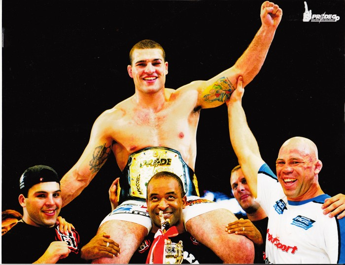 Cordeiro celebrating his Pride championship win w/ the UFC's Shogun Rua & Wanderlei Silva