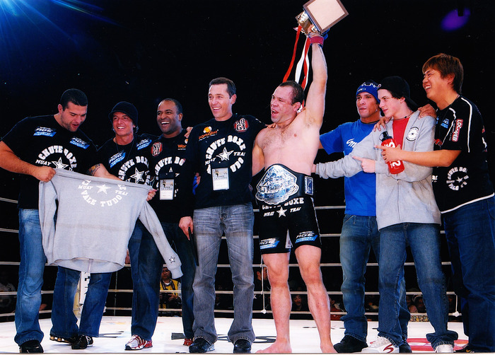 Cordeiro celebrating with his Pride championship win for Wanderlei Silva!