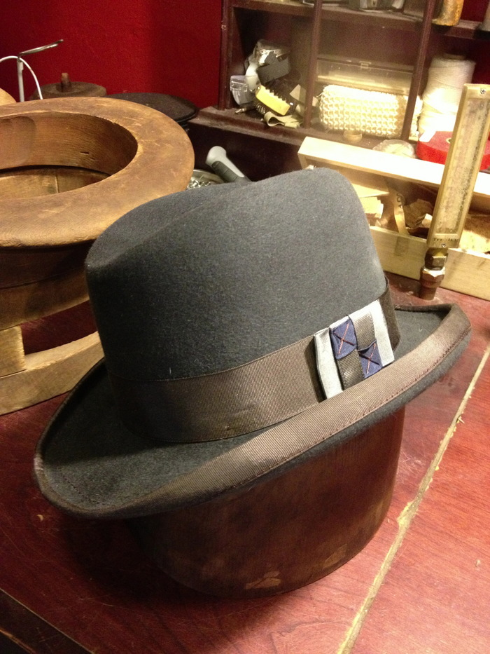 A gray fur felt Homburg, bound edge and hand sewn ribbon and bow.