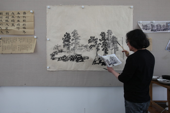 "Xu Bing painting a Landscript (a landscape painted using Chinese characters). ""Enduring Passion"" shows ten great artists at work in their studios. (Photo copyright ©2012 Britta Erickson)"