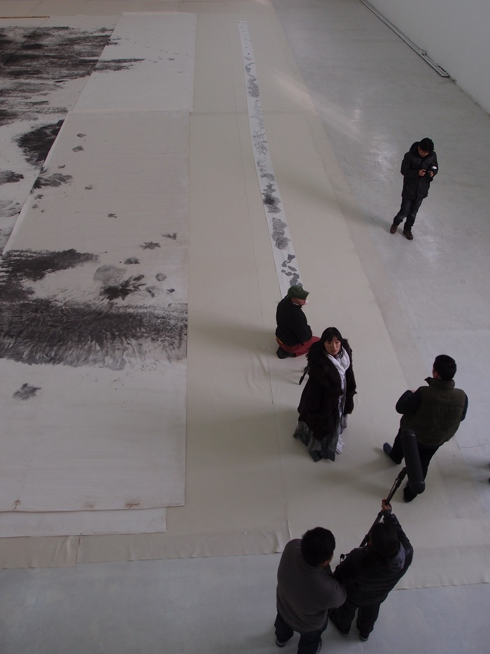 "Huang Bingyi showing one of her monumental paintings. Ink is a versatile medium, and ""Endless Passion"" includes artists working in a wide range of styles. (Photo copyright ©2012 Britta Erickson)"
