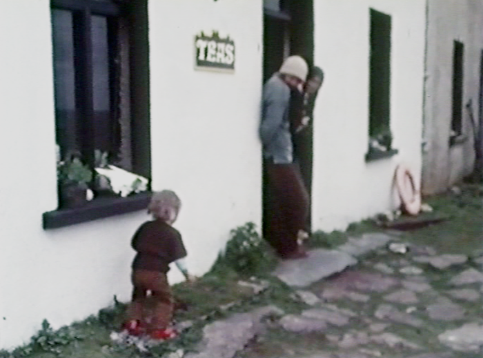 Daniel, Roger and Lesley Hambrook outside their cafe and hostel on the uninhabited Great Blasket Island, 1977.