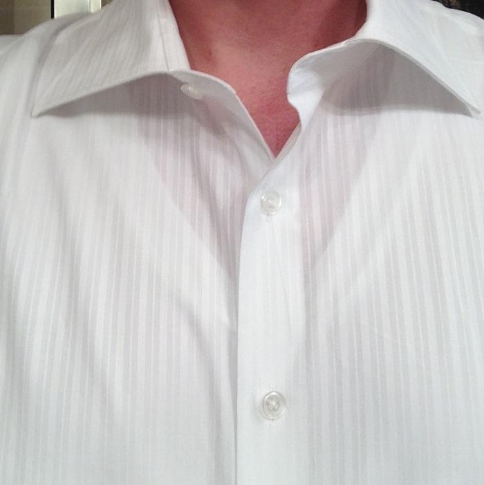 Standard white v-neck shows through.