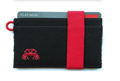 I didn't have the equipment to put the crab on the wallet, so I started making connections with some manufacturers to see how it could be done. This is the prototype they sent back with a crab embroidered on it.