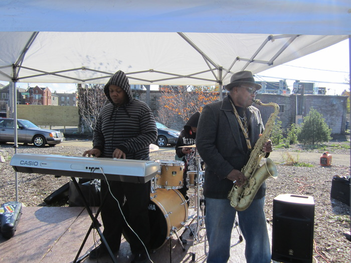 Local musicians perform along East Garfield Park's business district
