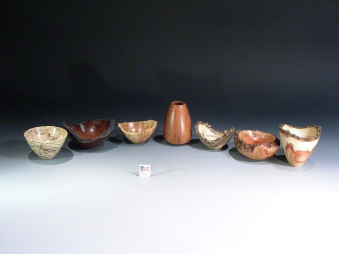 Level 7 set of bowls including the rosewood vase