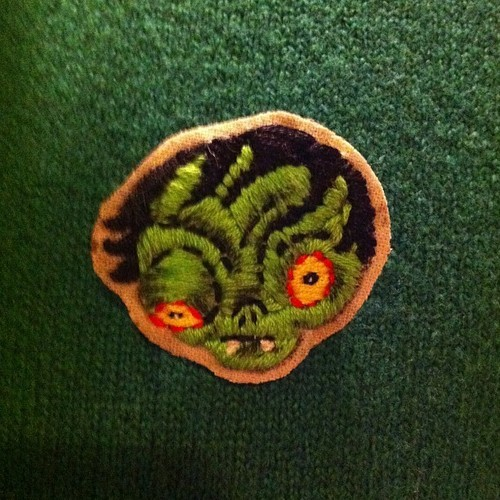The amazing and talented Jenn Woodall will be contributing hand-made embroidered Lovecraft pins!