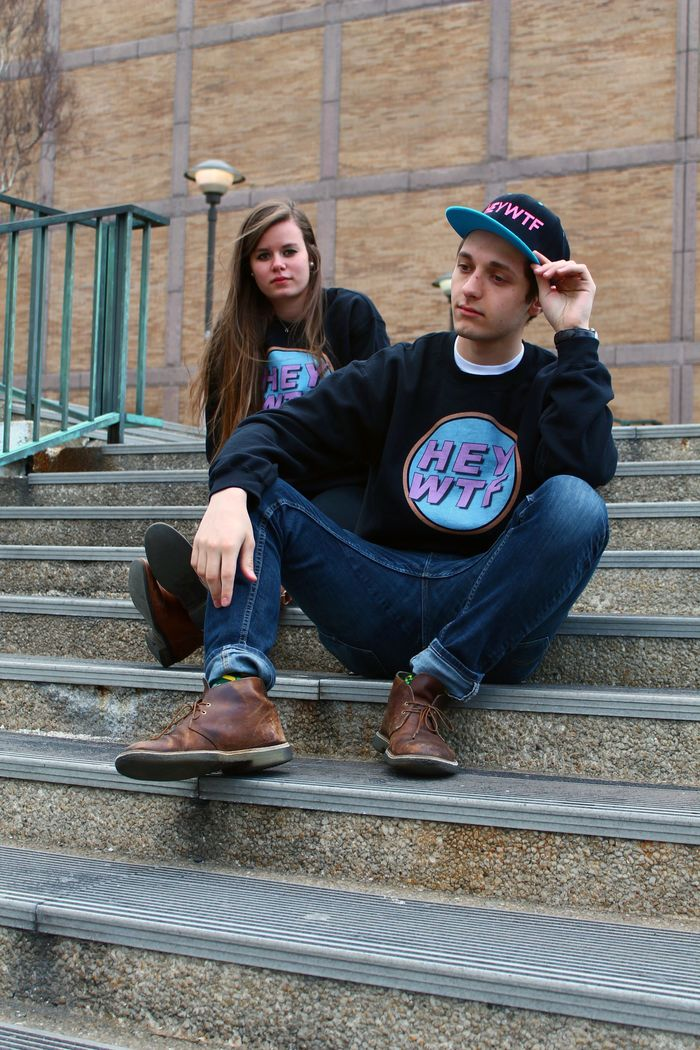 The Black HEY WTF Crewneck ($35) and Snapback ($30)