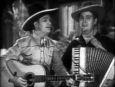 Smiley Burnett with Gene Autry.